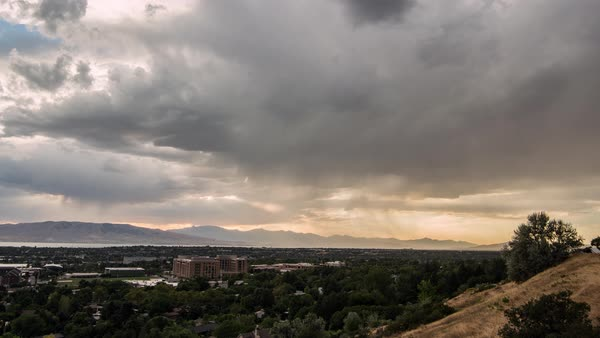 Time lapse of stormy clouds at sunset moving over Provo Utah Royalty-free stock video