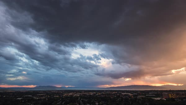 Time lapse of colorful sky at sunset over looking Provo Utah looking towards Utah Lake. Royalty-free stock video