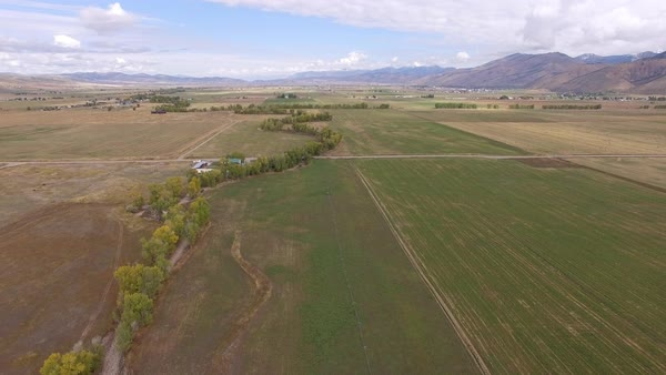 Aerial view of countryside in Star Valley Wyoming flying backwards. Royalty-free stock video