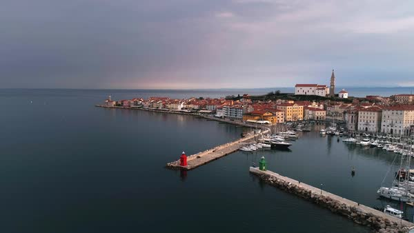 Panning aerial view of Piran Slovenia on a cloudy day as dark storm clouds roll in. Royalty-free stock video