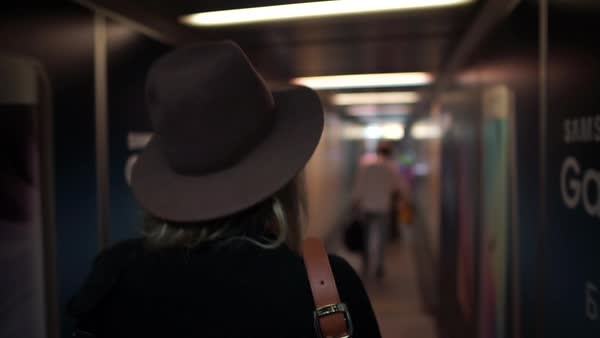 Medium shot of a woman walking in a corridor Royalty-free stock video