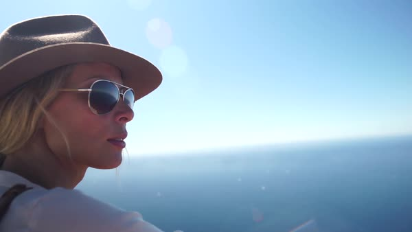 Medium close-up shot of woman looking over the sea Royalty-free stock video