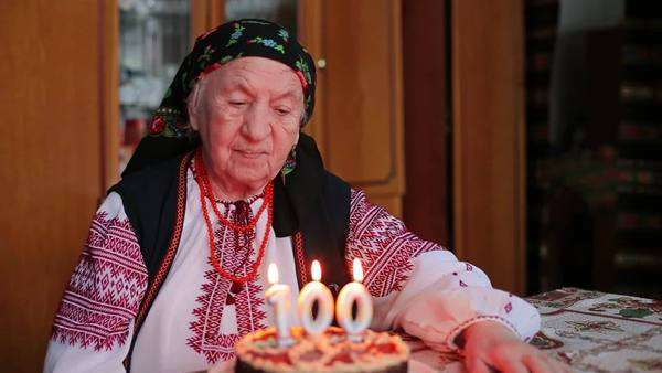 Grandmother Blows Out Candles On 100th Birthday Cake With Granddaughter Royalty Free Stock Video