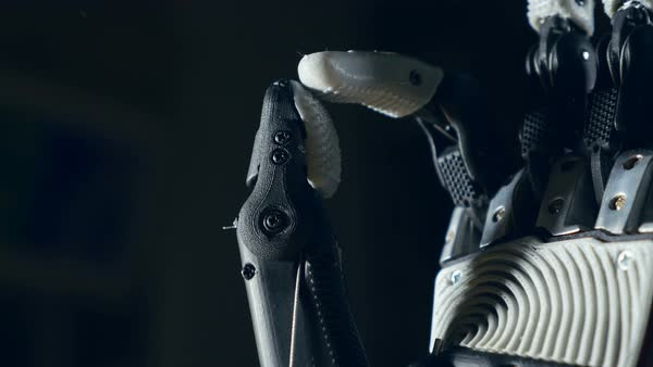 Robotic arm. Futuristic cyborg arm in action. Royalty-free stock video