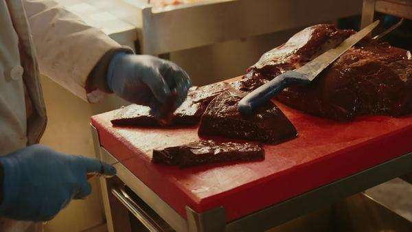 Close up of butcher cutting meat on cutting board Royalty-free stock video