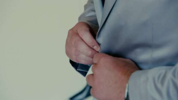 Close up groom preparing buttons up costume Royalty-free stock video
