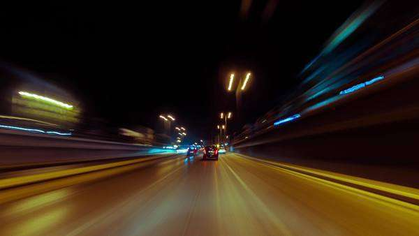 Point-of-view night driving in traffic, hyperlapse. Shot in the center of Athens, Greece, from outside the windshield of a car at eye level Royalty-free stock video