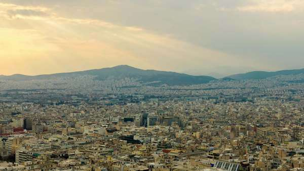 Timelapse Athens Greece skyline establishing shot at sunset. Skyline of Athens with Acropolis in the background at sunset. All unwanted elements have been digitally removed and sequence has been deflickered. Royalty-free stock video