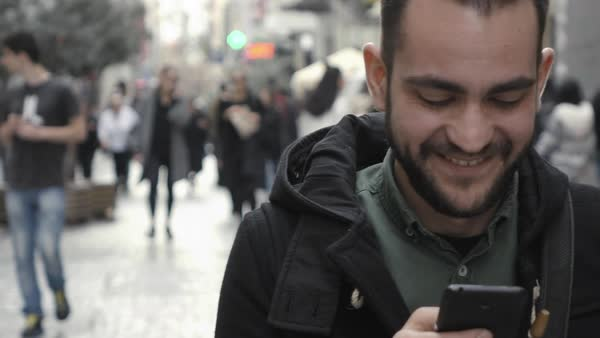 Young man using smartphone in public commercial street. Royalty-free stock video