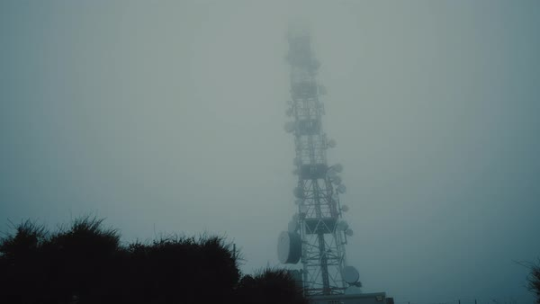 Communication broadcast and cell tower on mountain top in heavy fog. Royalty-free stock video