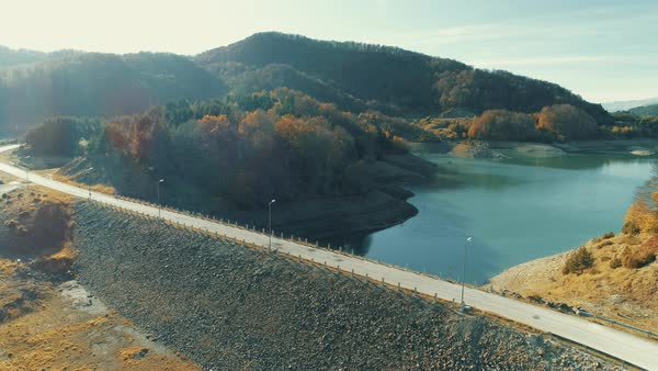 Aerial shot of the artificial lake of Aoos ar Zagorochoria of Epirus in Northern Greece during the autumn  season.  Royalty-free stock video