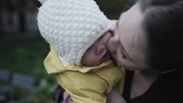 Close-up shot of a mother kissing her baby Royalty-free stock video