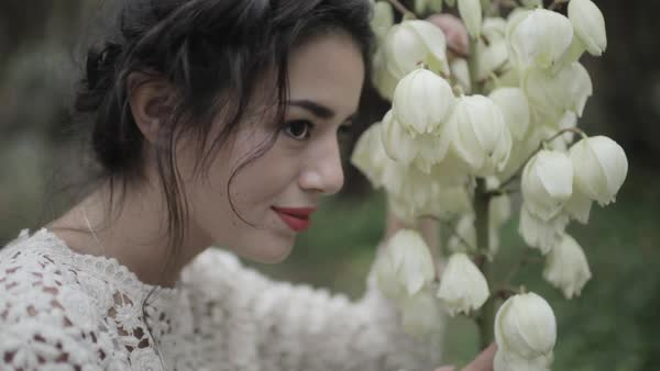 Medium shot of a woman posing with yucca flowers Royalty-free stock video