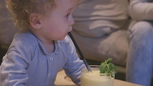 Hand-held shot of a toddler drinking through a straw Royalty-free stock video