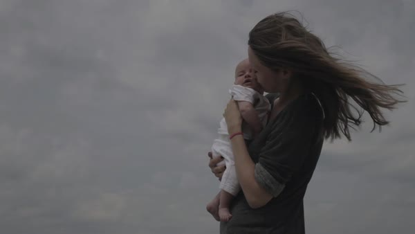 Hand-held shot of a young mother kissing face of her baby Royalty-free stock video