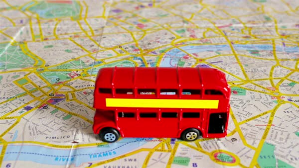 Stop motion of the famous London red bus toy moving over a map of London, part 5 Royalty-free stock video