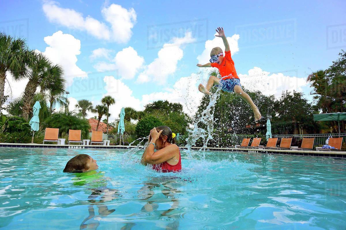 Kids Having Fun In A Swimming Pool In Florida - Stock Photo - Dissolve