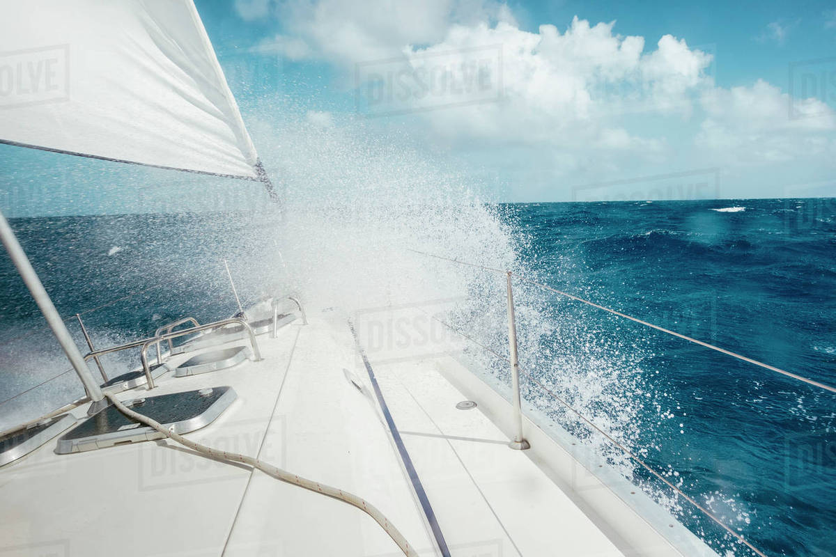 Sail Boat Sailing In The Rough Sea Of Caribbean stock photo