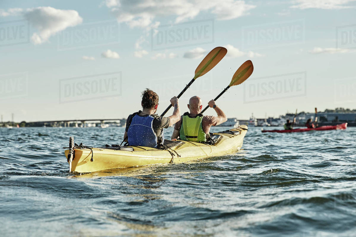 Photograph Of Two Men Paddling In Tandem Sea Kayak Portland Maine USA