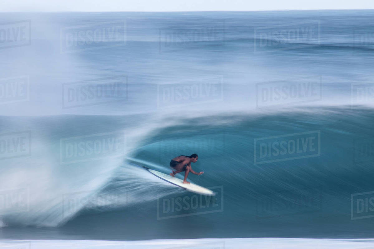 714fe046e5 A surfer riding a big wave at the world famous Banzai Pipeline