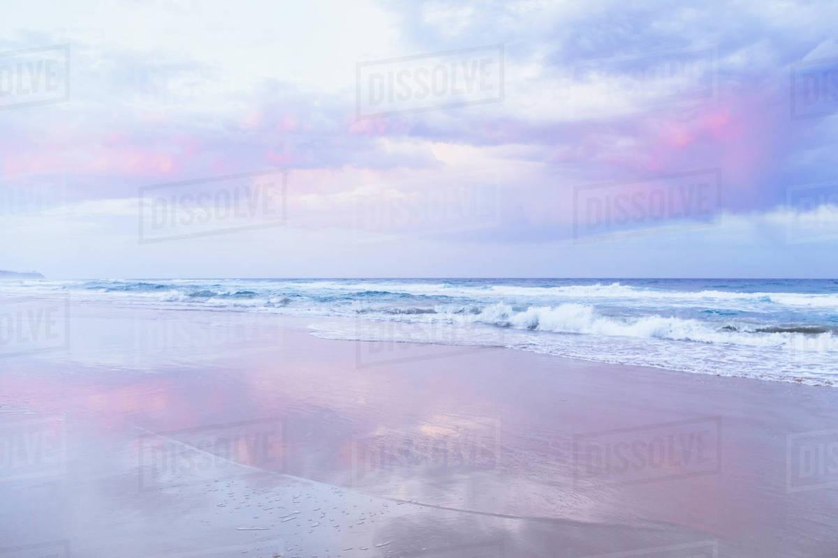 Beautiful Beach And Ocean Landscape With Pink Sky Sunrise Queensland Australia
