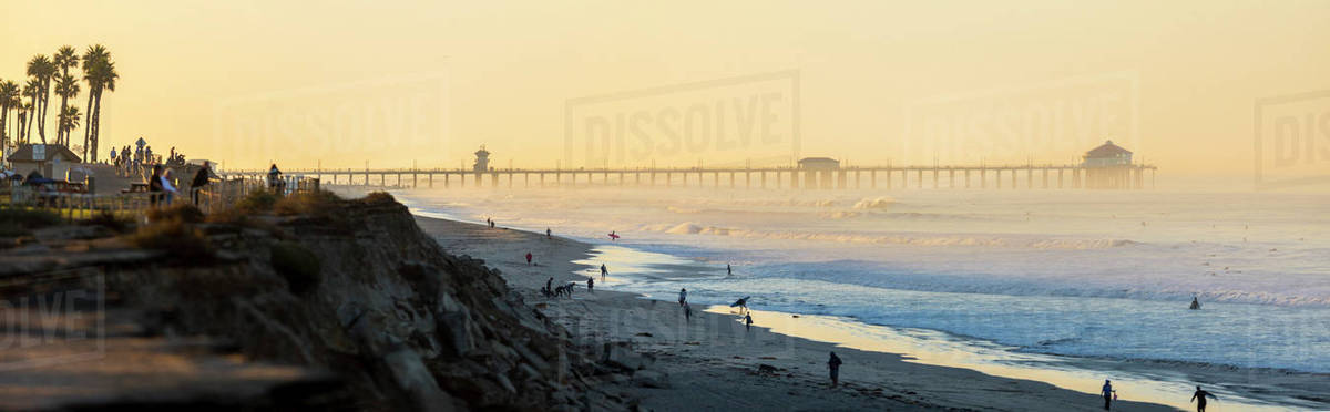 Panorama of Huntington Beach with pier in background at sunset, California,  USA stock photo