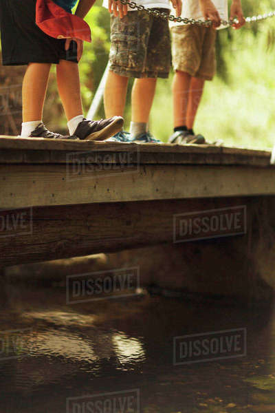 Kids at summer camp in San Diego, California, stand on a small bridge. Royalty-free stock photo