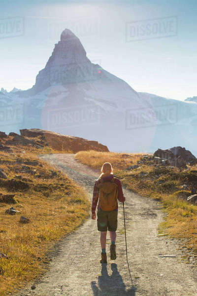 Female Hiker Is Walking In Front Of The Famous Matterhorn Royalty-free stock photo