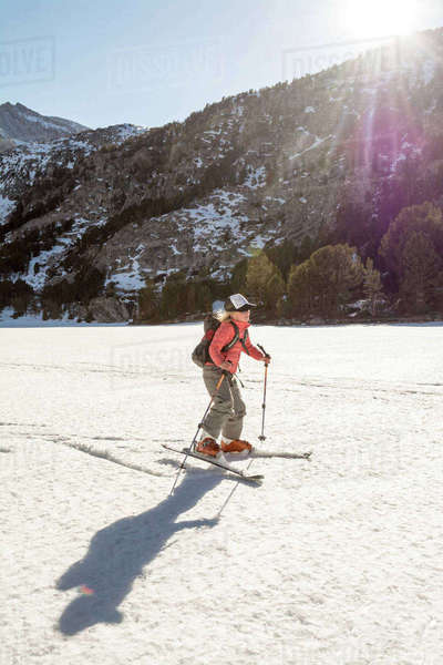Young Girl Ski Skating On A Frozen Lake In Rock Creek Canyon, California, Usa Royalty-free stock photo