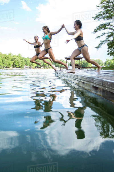 Group Of Female Friends Jumping In Lake At Alabama Royalty-free stock photo