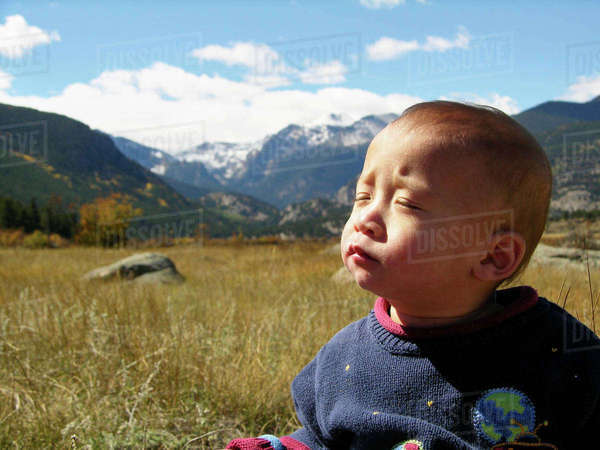 Little Boy Facing The Morning Sun In Rocky Mountain National Park, Colorado Royalty-free stock photo