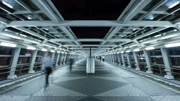 Timelapse night view of futuristic pedestrian passageway with people walking in Odaiba, Tokyo, Japan Royalty-free stock video