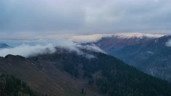After sunset timelapse in high snowy mountains with clouds. Royalty-free stock video