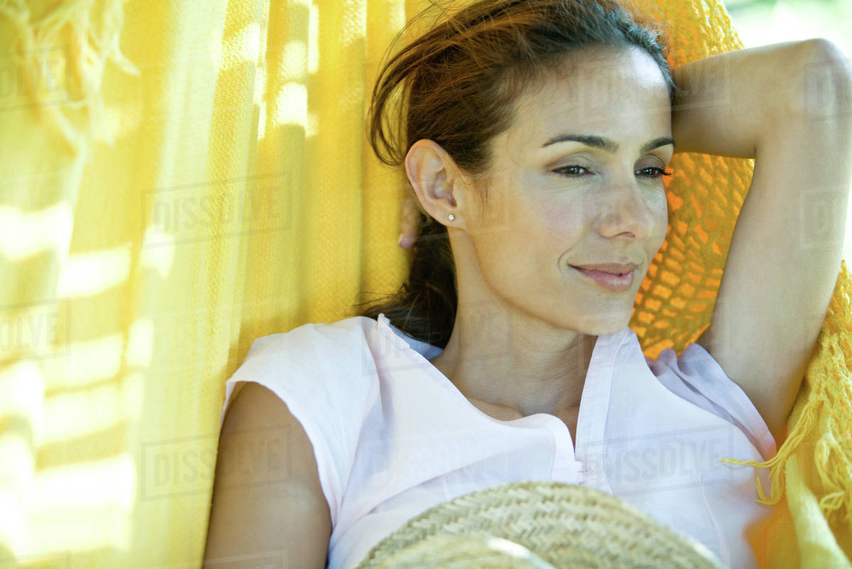 Woman resting in hammock, head and shoulders Royalty-free stock photo