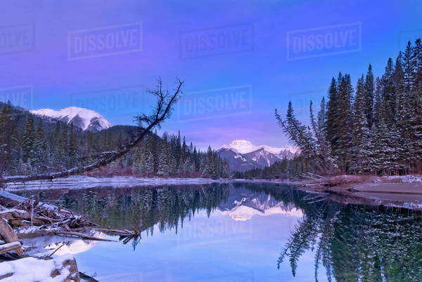 Calm river in the spring with a snowy mountain behind Royalty-free stock photo