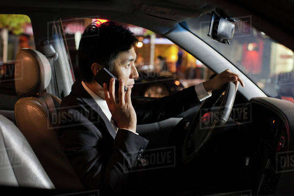 Businessman With Cell Phone In Car Royalty-free stock photo