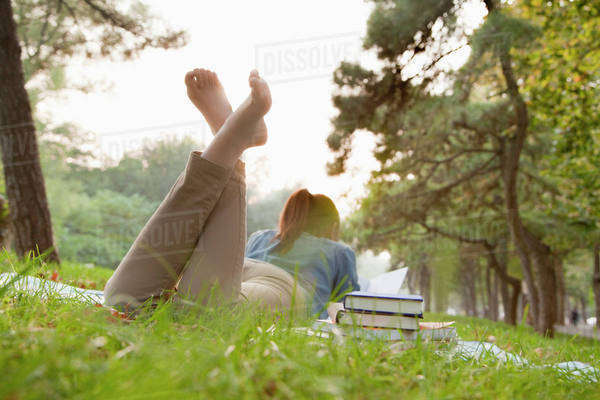 Teenage girl reading book in the park Royalty-free stock photo