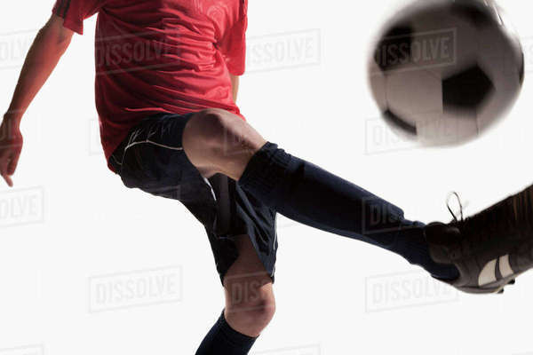 Soccer player kicking soccer ball Royalty-free stock photo