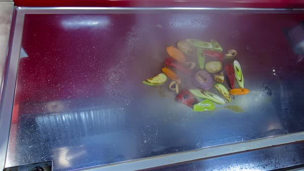 Raw vegetables for roasting, cooking on a baking tray timelapse Royalty-free stock video