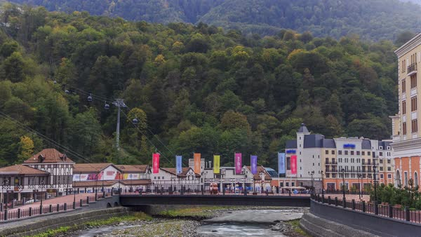 Settlement of municipal type Krasnaya Polyana and the river with bridge Mzymta timelapse Royalty-free stock video