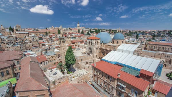 Roofs of Old City with Holy Sepulcher Church Dome timelapse, Jerusalem, Israel. Top view with blue cloudy sky Royalty-free stock video