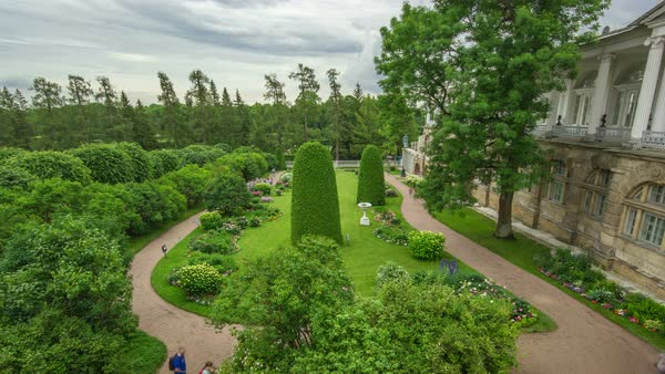 Antique gallery with sculptures and garden in the Catherine park timelapse, Saint-Petersburg. Floral compositions, trees, bushes. Cloudy summer day Royalty-free stock video