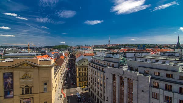 Top view from the height Powder Tower in Prague timelapse to Vitkov Memorial and Zizkov Television Tower with traffic on the street. Historical and cultural monument. Prague, Czech Republic. Royalty-free stock video