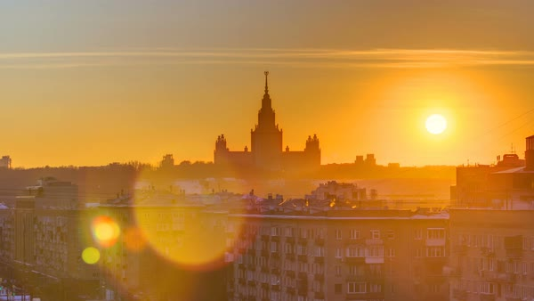 Sunset Moscow State University in winter timelapse top view from Komsomolskiy avenue with roofs Royalty-free stock video