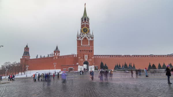 View of The Saviour (Spasskaya) Tower timelapse hyperlapse and Kremlin walls of Moscow Kremlin, Russia at day in winter. View from Red Square Royalty-free stock video