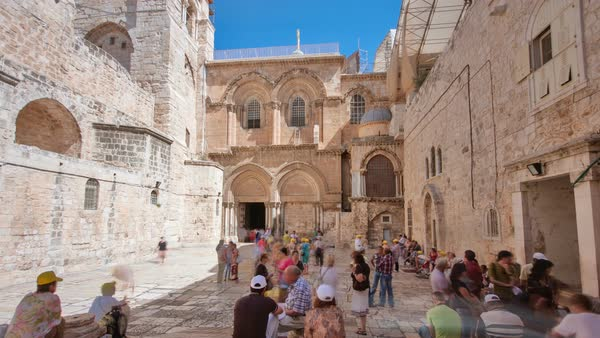 Vew on main entrance in at the Church of the Holy Sepulchre in Old City of Jerusalem timelapse hyperlapse at sunny day Royalty-free stock video