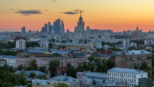 Skyscrapers day to night transition timelapse from rooftop, Kremlin towers and churches, stalin houses at evening aerial panorama in Moscow, Russia. Sunset sky Royalty-free stock video