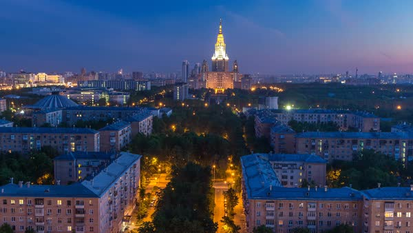 Moscow State University night to day transition timelapse before sunrise aerial view from rooftop. Popular landmark in Moscow the capital of Russia. Morning mist Royalty-free stock video