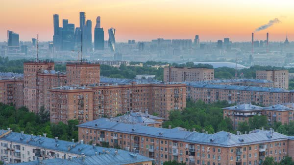 View from top of cityscape timelapse, residential buildings, park areas, group of Moscow City skyscrapers in distance, horizon, morning mist and sunrise, Moscow, Russia. Aerial view from rooftop on Leninskiy avenue Royalty-free stock video