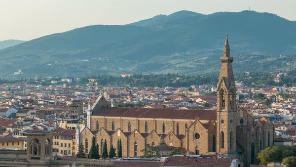 Florence aerial cityscape view timelapse from Michelangelo square on the old town with Santa Croce church in Italy before sunset. Mountains on background. Royalty-free stock video